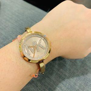 MK studded bracelet watch